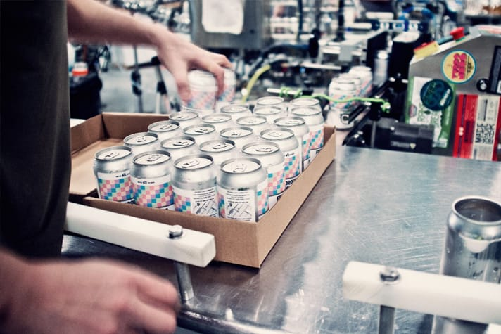 Beer cans being packaged