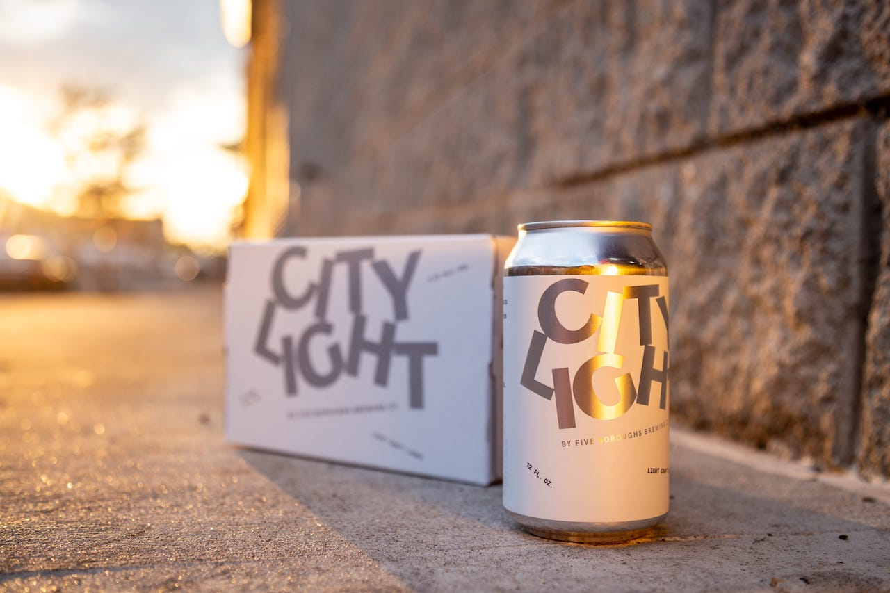 boxes of the city light beer cans