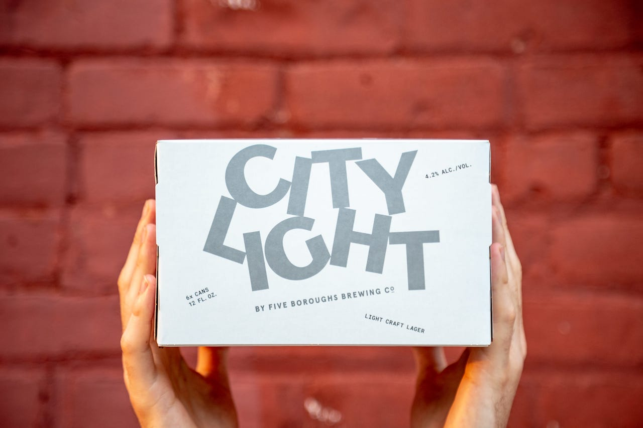city light beer cans being packaged